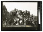Scene In The Redwoods. Group of men, women, children, posing at a large redwood stump by Augustus William Ericson