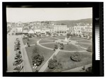 Looking north over the Arcata Plaza with cars parked along H St. by Augustus William Ericson